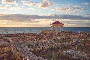 Beautiful landscape with sunset and Royal gazebo on the background of the sea landscape. photo