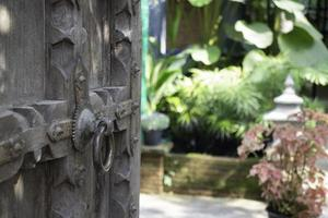 Old open wooden door with carved pattern photo