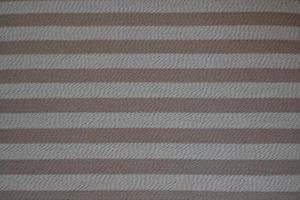 Rough texture background in beige and dirty white, made with horizontal stripes in brown tones photo