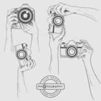 Sketch camera in hand,potography illustration Premium Vector