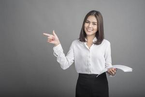 Business woman in white shirt on grey background photo