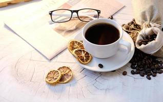 coffee cup on table background and coffee in the morning photo