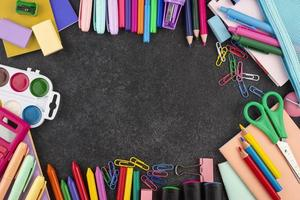 Back to school background with school supplies photo