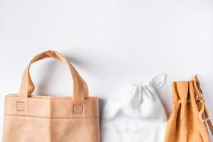 Zero waste concept. Set recycled home accessories - eco-friendly bags and wooden supplies photo