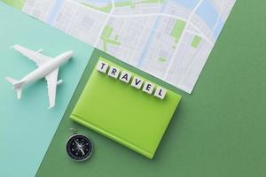 Travel concept with white plane and map photo