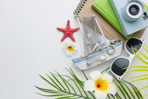 Travel items on white background flat lay photo