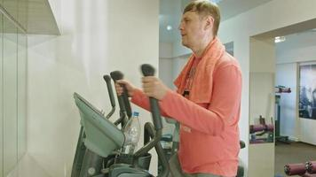 Man with Elliptical Machine in The Gym video