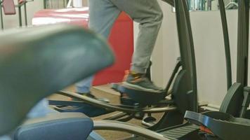 Man Exercising on a Elliptical Machine video