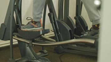 Man on a Elliptical Machine in The Gym video