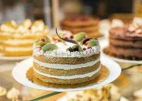 Delicious cake with fruits and cream photo