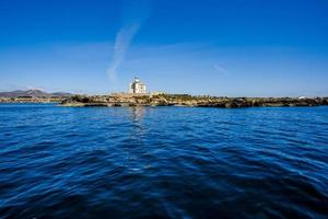 Lighthouse on the coast photo