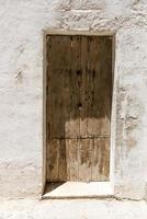 Wood door and white building photo