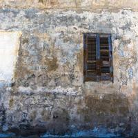 Wood shutters on old building photo