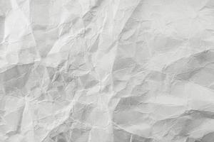 Crumpled white paper, texture background. photo