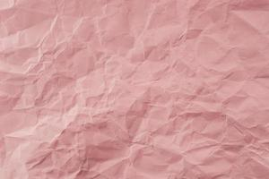 Crumpled Rose paper with soft texture. Simple background. photo
