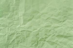 Crumpled Green paper with soft texture. Simple background. photo