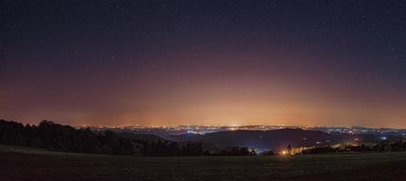 Starry night sky panoramic photo with a beautiful view from mountain Rajac, Serbia. The night sky is astronomically accurate.