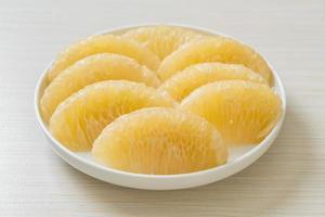 Fresh peeled pomelo grapefruit or shaddock photo