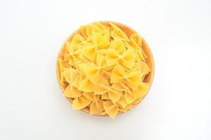 Dry uncooked farfalle pasta on white background photo