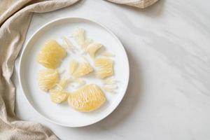 Fresh peeled pomelo, grapefruit or shaddock photo