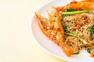 Stir-fried rice vermicelli and water mimosa with river prawns photo