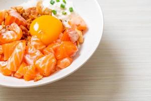 Japanese rice with fresh salmon raw and egg photo