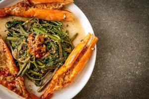 Stir-fried water mimosa with river prawns photo
