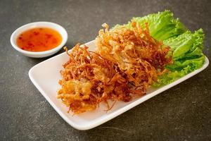 Fried enoki mushroom or golden needle mushroom - vegan and vegetarian food style photo