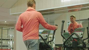 A Man Using a Cyclical Machine video