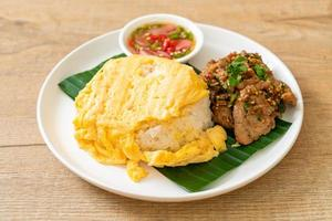 Egg on topped rice with grilled pork and spicy sauce - Asian food style photo
