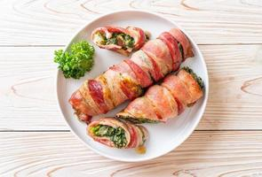 Baked bacon roll stuffed spinach and cheese photo