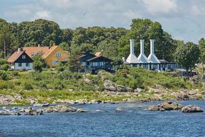 Smoke houses typical for the small village of Svaneke on Bornholm island, Denmark photo