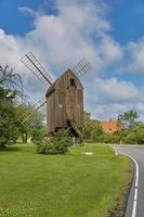 Timbered post mill in Denmark, Svaneke Bornholm island photo