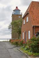 Lighthouse tower in Svaneke on the island Bornholm, Denmark photo