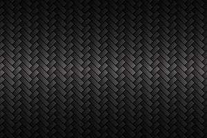Black abstract carbon fiber background. Modern metallic look. The look of stainless steel. Vector illustration
