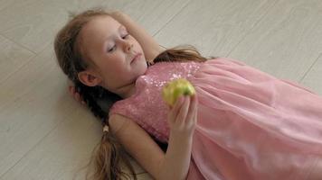Little girl eating an apple video