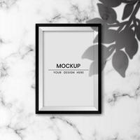 Realistic photo frame mockup with white marble background and shadow overlay effect vector