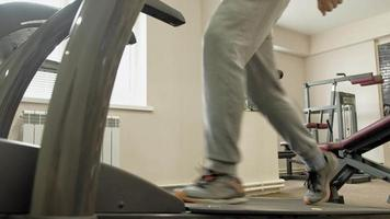 An overweight man on a treadmill at the gym. Fitness, Healthy lifestyle video