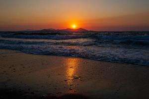 Sunset on coastline of Kos Island in Greece photo