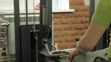 The overweight man exercises in the gym. Fitness and Health lifestyle video