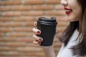 Woman is drinking coffee. Relax lifestyle concept. photo