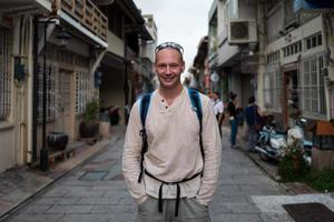Caucasian man smiling on the streets of Tainan in Tainan photo