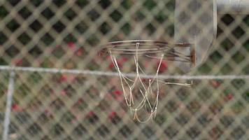 A young man basketball player missing a dunk on an old outdoor basketball hoop. video