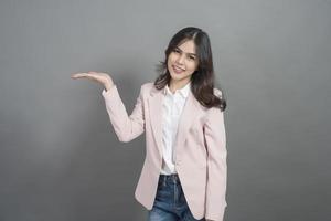 Asian businesswoman are smart, portrait in studio grey background photo