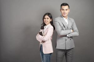 Businessman and businesswoman are smart portrait in studio photo