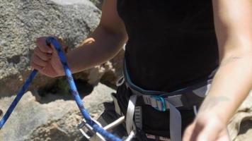 Rock climbing detail of a belay device. video