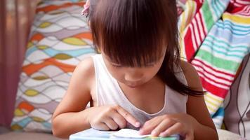 Cute little preschooler child drawing and coloring at home, Stay at home during the coronavirus outbreak. Homeschool concept. video