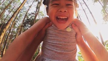 Happy father holding little girl smiling and playing in summer on the nature. video
