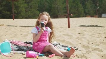 Girl eats ice cream outdoors video