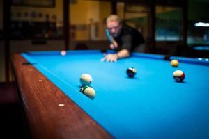 A man playing Pool Billiard photo